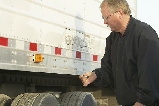 driver carrying out a truck inspection