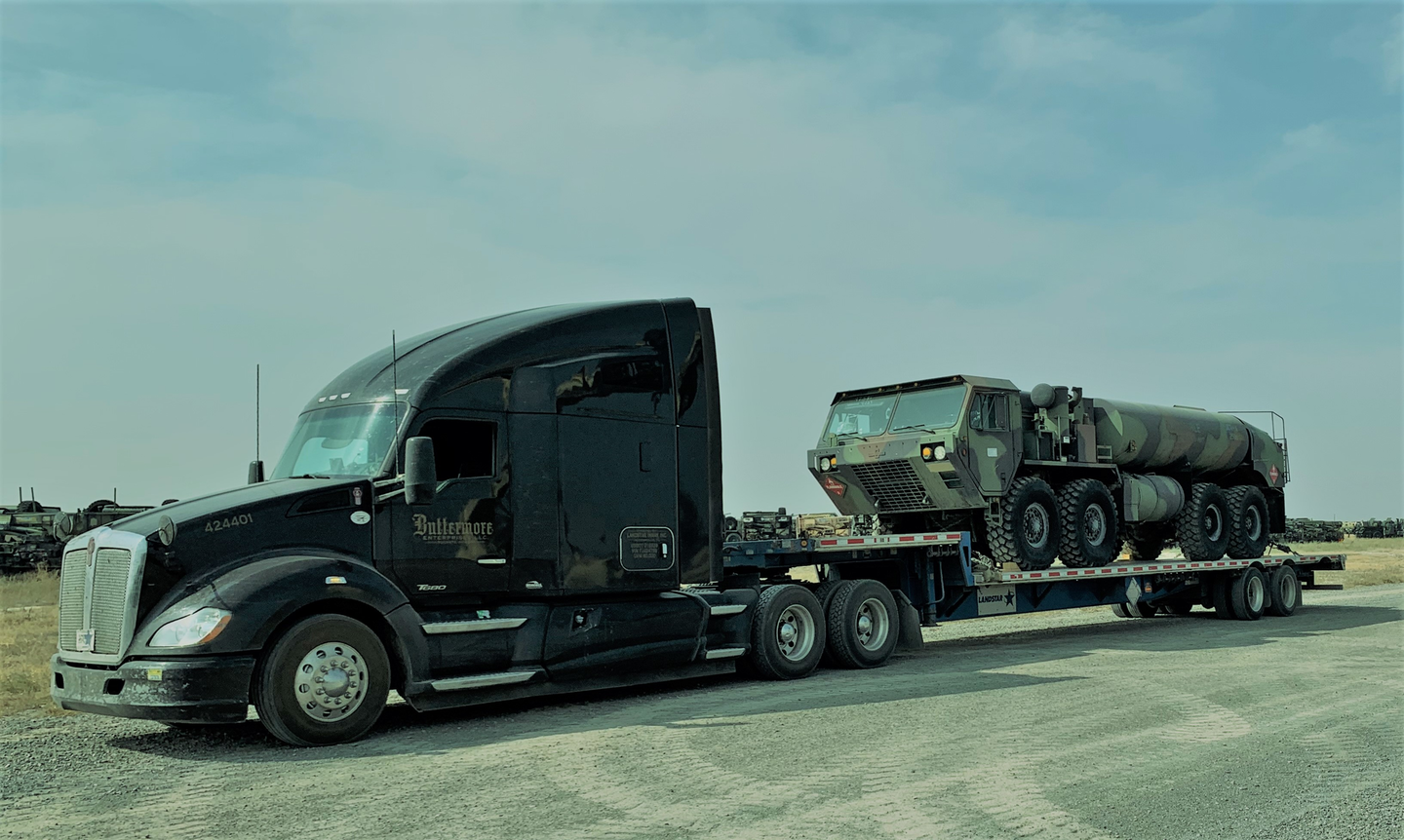 Lance Buttermore's 2015 Kenworth t680 carrying military machinery