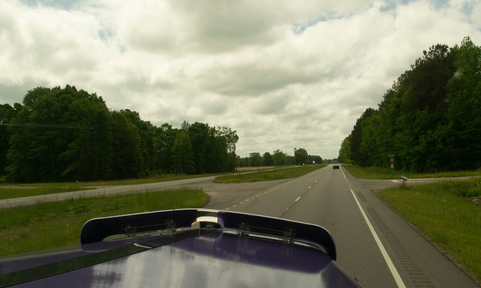 Overcast sky and highway from passenger's seat of a semi-truck