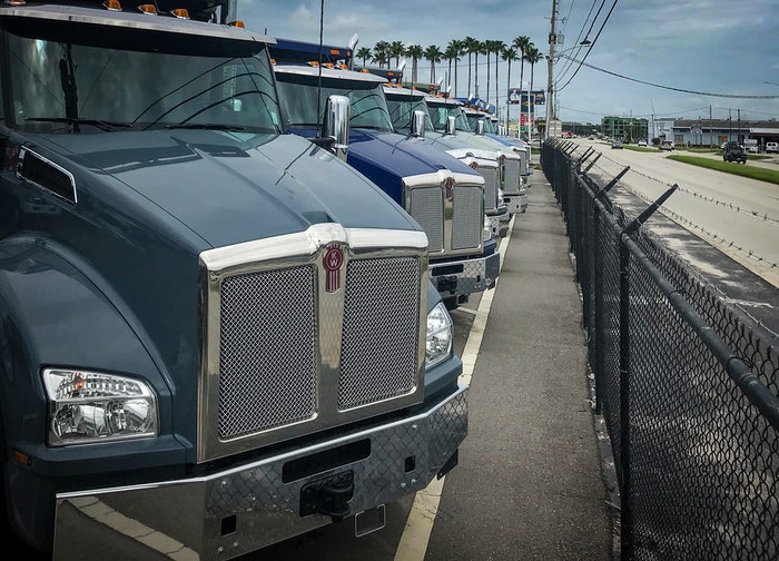 semi trucks parked in a row