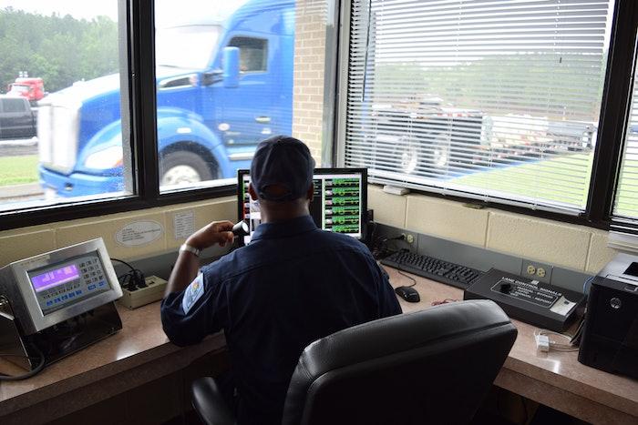 Inspection Officer Screening Trucks Scale