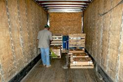 man unloading pallets into truck