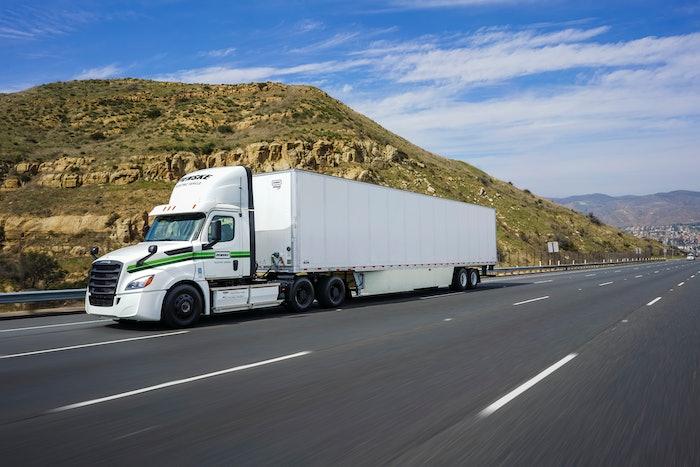 penske truck driving on roadway