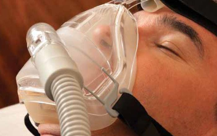 man with sleep apnea mask on
