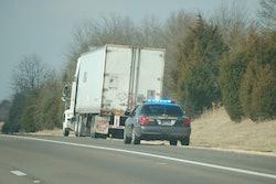trooper pulling over semi truck