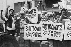 truck drivers in front of a semi-truck holding signs with the text shutdown #2 january 31 until as long as it takes on them