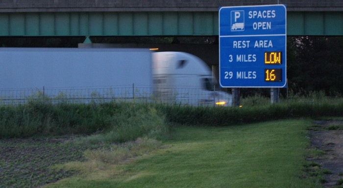 truck passing parking highway sign