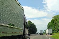 Trucks on highway with one broken down