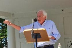 Bernie Sanders speaking at a podium