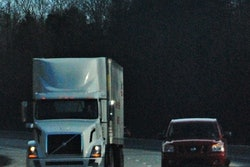 semi truck and vehicle on highway