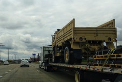 Military Vehicle On Flatbed Truck Highway
